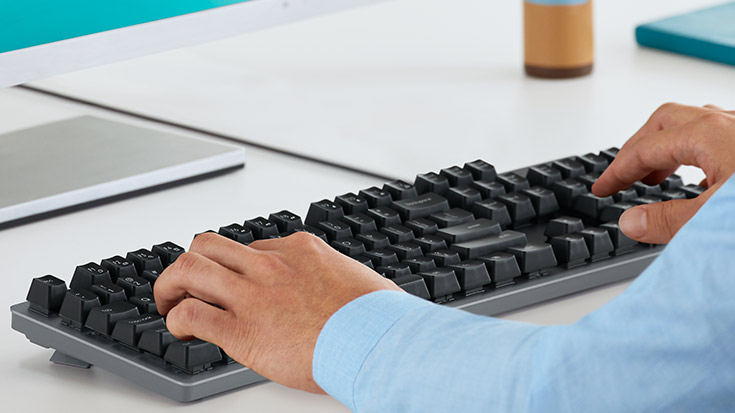 Two hands typing K840 Mechanical Keyboard