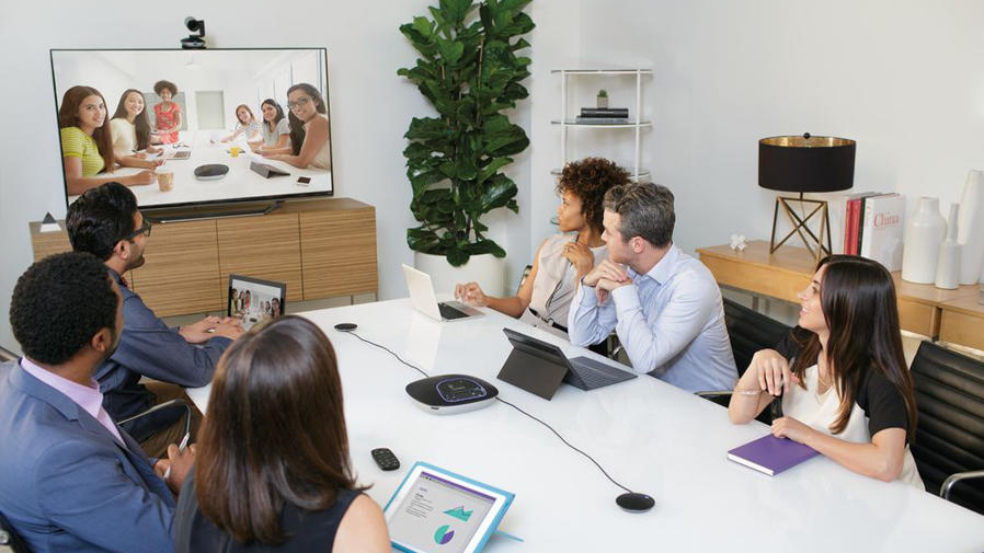 People in a Confernce Room using video collaboration