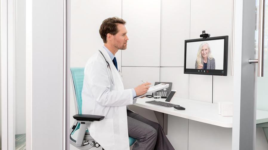Doctor talking to patient via conference cam