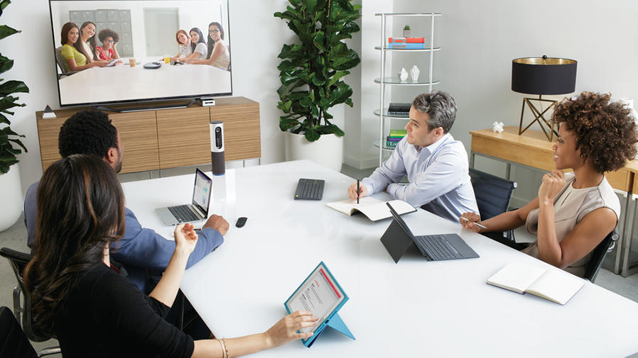 People around video conference table