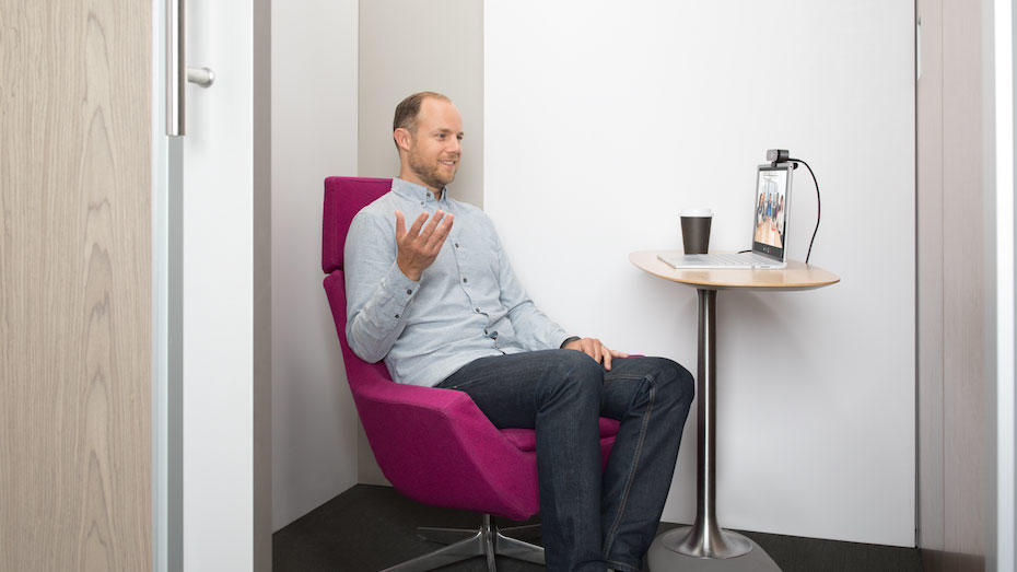 A man in video conferencing with logitech products